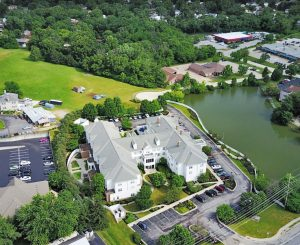 Charter Senior Living of Edgewood Aerial View with lake
