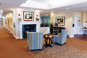 Charter Senior Living of Edgewood community sitting area with fireplace